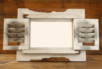 vintage white wooden frame with shutters. ready template