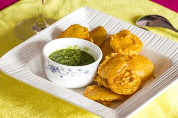 Indian deep fry snacks cooked using potato and gram floor