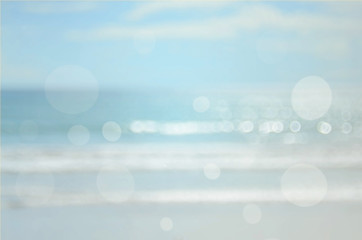 Blur beach with bokeh wave abstract background.