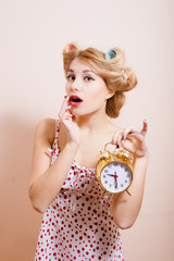 Housewife with alarm-clock