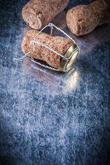 Set of champagne corks twisted wire on metallic background copys