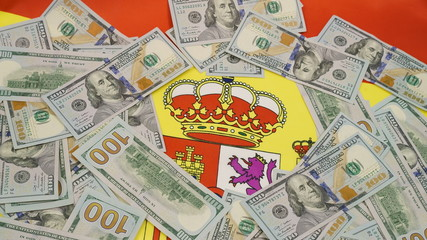 flag of Spain  and lots of hundred dollar bills