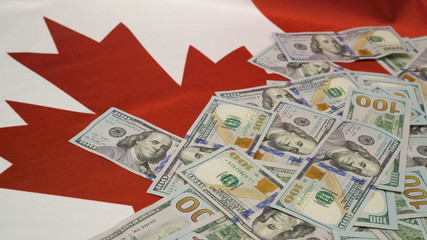 canadian flag and lots of hundred dollar bills