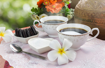 Double cup hot black coffee in fresh and happy morning for the lover relaxation on harmony natural green background