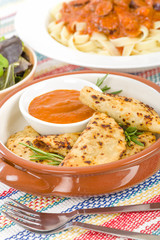 Pierogi - Baked dumplings filled with meat and served with a spicy sour cream based dip.