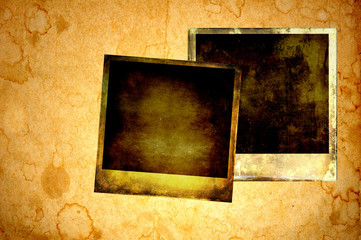 Blank instant photos on grunge paper background
