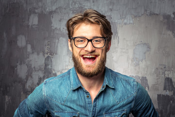 Young handsome man in glasses smiling