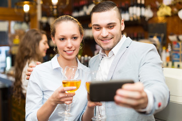 People doing selfie at cafe