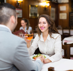 Woman having dinner with guy