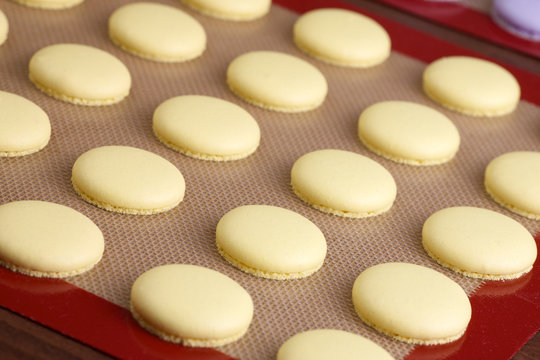 baked yellow macaroon on silicone mat