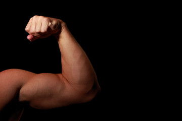 Man's Arm Flexing Muscle