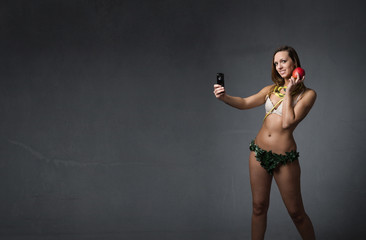 eve taking selfie with apple