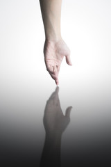 human hand with water reflection . Conceptual Photography - Help Concept