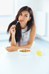 Portrait of woman eating cereals. Healthy eating. Health care. W