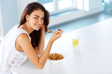 Wellness concept. Woman having breakfast and smiling. Healthy ea