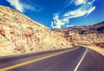 Vintage stylized country road in USA, travel concept.