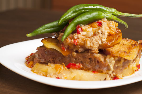 meatloaf with mashed potatoes and green chillies