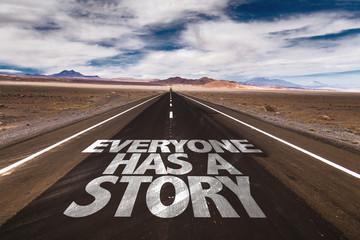 Everyone Has a Story written on desert road