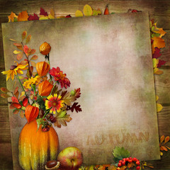 Vintage background with a bouquet of autumn leaves and berries in a vase from pumpkin