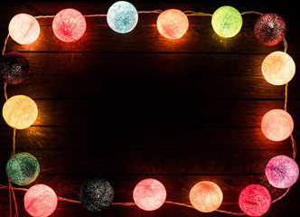 Wooden background with border from christmas lights