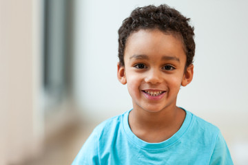Portrait of a cute little African American boy smiling Wall mural