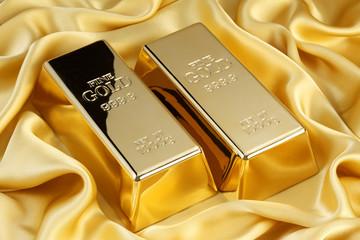 金の延べ棒/金色のシルクの上のゴールドバー
