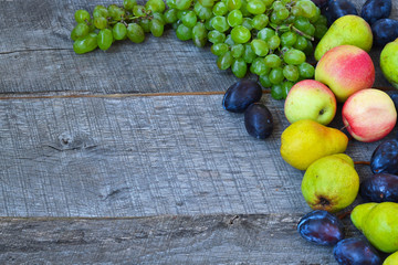 Sets fruit on wooden background.Copy space background.