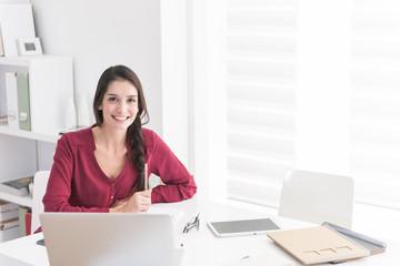 Portrait of an designer working home on new ideas. A dark hair b