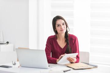 Portrait of a designer working home on new ideas A dark hair bra