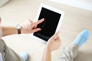 Man working with digital tablet at home