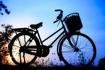 beautiful landscape image with Bicycle silhouette  at blue tone
