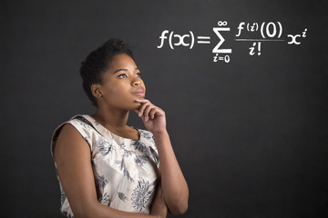 African American woman with hand on chin thinking about maths on blackboard background