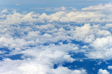 Clouds and sky from airplane window
