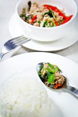 spicy pork with hot basil on stream jasmine rice