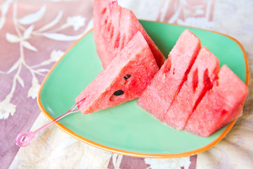 Sliced ripe watermelon on plate