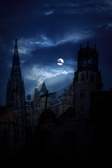 Mysterious medieval castle and the cathedral church at night