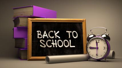 Back to School Handwritten on Chalkboard.