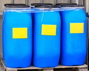 Blue packed barrels with yellow labels