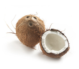 coconut whole and half on a white background