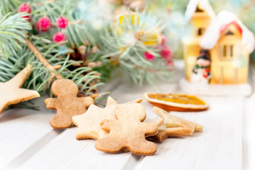 Christmas gingerbread on the background of fir branches and drie