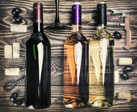 Bottle of wine and accessories on a wooden table