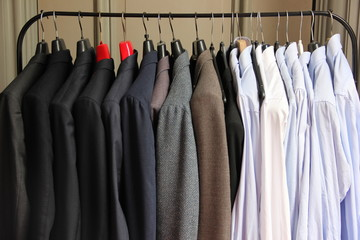 A cloth rack filled with suits