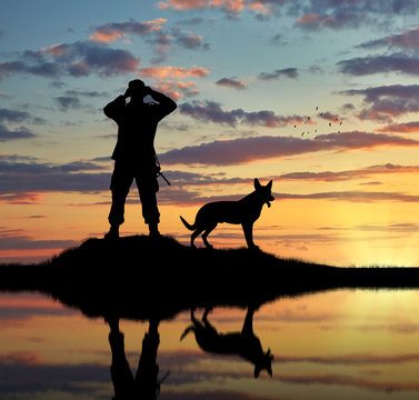 Silhouette of a dog and a soldier
