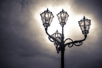 Streetlight of nineteenth century in the middle of a square with