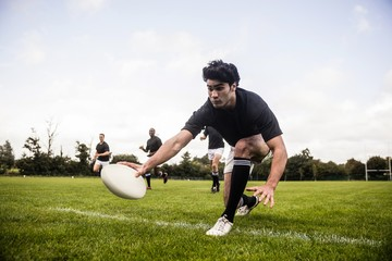 Rugby players training on pitch