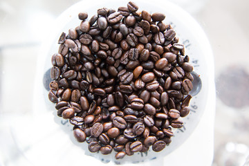 Coffee beands inside a grind machine