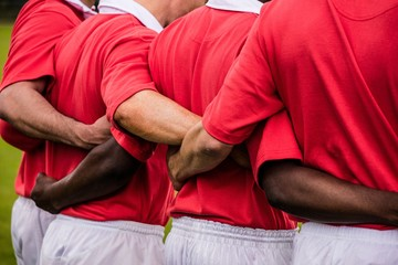 Rugby players standing together before match