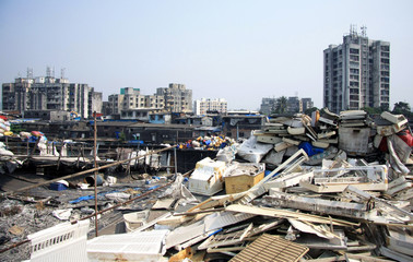Mumbai Waste piles on rooftop slums