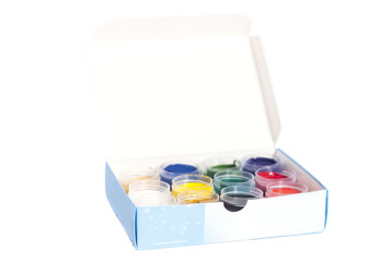 Open colorful cans of gouache paint in box isolated