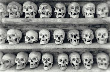 Human skulls inside a catacomb.